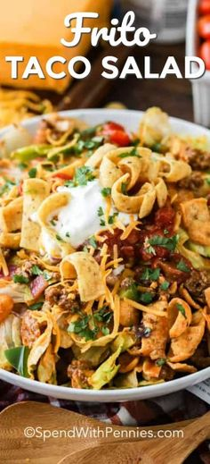 This Frito taco salad is a fun twist on a classic taco salad. Just brown your meat mixture, top your lettuce with you favorite toppings, like salsa or guacamole, and dive in! salad recipe Frito Taco Salad - Spend With Pennies Frito Taco Salad, Taco Salad Recipes, Mexican Food Recipes, Beef Recipes, Dinner Recipes, Cooking Recipes, Healthy Recipes, Lettuce Recipes, Healthy Dishes