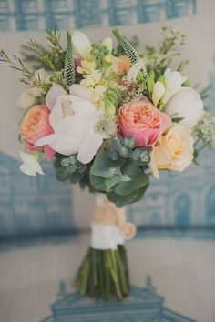 """Image by Kari Bellamy Photography. - A Fifties Style Wedding At Beacon House In Whitstable With Green Wedding Shoes And A """"Grace"""" dress by Allure Bridals With A Peach And White Bouquet By Kari Bellamy Photography."""