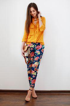 floral pants, bright shirt.
