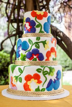 This bright, bohemian inspired cake is perfect for the fun loving bride who is interested in an artsy design over the traditional wedding cake.     cake: All American Sweets - Memphis, TN photo: Christen Jones Photography