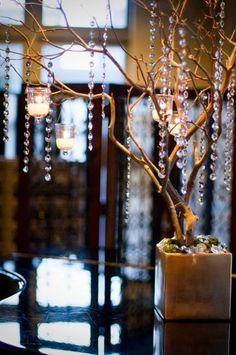 could spray paint branches any color, drape beads, use on guest book table or buffet line or on either end of the head table. I have alot of cylinder and rectangle vases from Heather's wedding