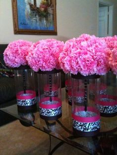 carnation centerpieces: with white or teal flowers and maybe pictures going around on the bottom instead of the ribbon