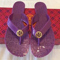 Tory Burch Purple Flip Flops with Gold Logo So cute! Tory Burch Purple Flip Flops with Gold Logo perfect color for summer! Size 7. Previously loved. Gold logo has some scratching, see photos. Has scuff on inside right shoe, please see last photo. Priced accordingly. Tory Burch Shoes Sandals