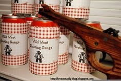 cowboy birthday party games - classic rubber band shooter and custom cans