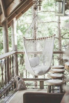 Garden furniture in wood and swing on the wooden deck