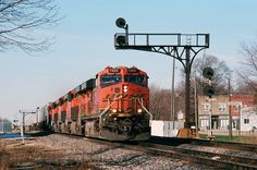 https://flic.kr/p/TonPQH | BNSF - Verona, IL | Eastbound trailers fly past the Santa Fe cantilevers and searchlights at Verona behind BNSF ES44DC No. 7224, on March 16, 2017.