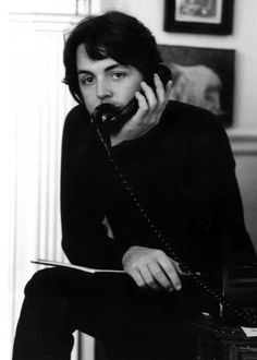 Bearded Paul McCarthy on the telephone  (Beatles) talking on the telephone back in the day they all came with cords attached to them