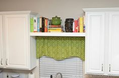 An additional shelf between your kitchen cabinets adds a bit of style and exta space for cookbooks, vases, or other items that have never quite found a home. See more at Sew Woodsy »