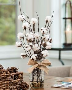 Faux Cotton Stems And Birch Branches Lend A Cozy, Farmhouse Ambiance To This Arrangement With Natural Pebbles And Tied With A Burlap Ribbon Bow. Country Farmhouse Decor, Farmhouse Furniture, Rustic Decor, Coastal Farmhouse, Apartment Decorating For Couples, Cotton Decor, Decorating With Cotton, Decorating Ideas, Decor Ideas