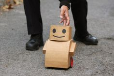Talk to Me Tweenbot via moma: Created by Kacie Kinzer in 2008, the cardboard robot was set loose in city parks with a sign asking for help to get to the other side... http://techrange.blogspot.com/2012/08/5-real-robots-made-from-everyday-stuff.html #Installation #Robot #Sociology