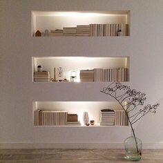 Organized, lit bookcases provide a hint of drama in a space.