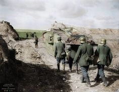 German POWs carrying a wounded man follow a tank of the 7th Battalion Tank Corps, WW1