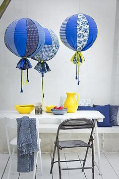 cute balloon lamps: you could easily take this idea and turn them into hot air balloons by covering blown up beach balls in material and then hanging them.  Add a small basket on the bottom