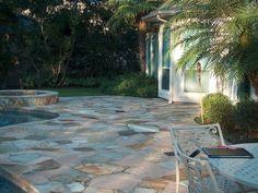 Flagstone pool surround patio.
