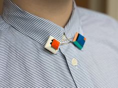 Collar pins. I'm not sure if I would but I should.