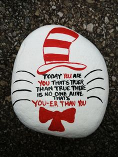 Cat in the hat quote rock painting