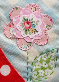 Pink applique flower. Love the blanket stitch on outside petals, and straight stitch on inner petals.