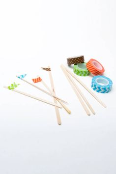 Forget plain toothpicks for party bites; add patterned paper tape to the end of stirring sticks #entertaining #holidayparties