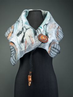 Chica Chimu cave art inspired sleeveless jacket worn as a bolero with large lapel. Double sided felt illustrated with a horse and a gazelle. Merino wool, mulberry silk, rose fibre.