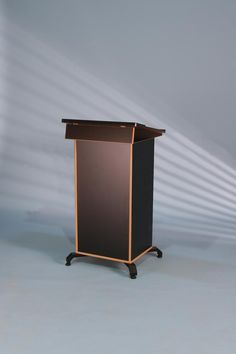 Post Style lectern with lockablecabinet and angled lift upworktop. Worktop is shaped andwrapped in a black vinyl for durabilityand looks. With the BGL-PSC75 being a lockable lectern your equipment can be housed safely on two fixed or removable shelves with clearance at the back for cables. The lectern legs are made from black powder coated …