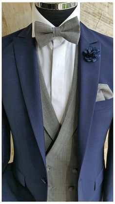 The Cobalt Blue Wedding suit , Prince of Wales Check Waistcoat . Worn with matching bow tie & pocket square.