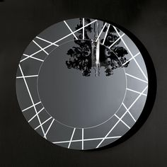 Sovet Italia Espejo de diseño Segment Diseño. Gianluigi Landoni. Espejo de diseño Segment Sovet Italia. Formado por segmentos grabados con luz LED.