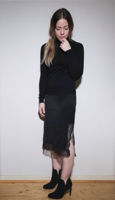 All black outfit, sweater with lace skirt.