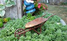 Miniature Rusty Tin Wheelbarrow