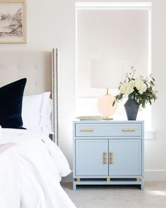 This bedside table creates so much visual interest. With a raised platform at the base gold leafed bamboo hardware and bluish gray white or navy finish its a piece that will stand out while remaining versatile. - March 09 2019 at Unique Home Decor, Cheap Home Decor, Creative Decor, Blue Nightstands, Unique Nightstands, Diy Dressers, Home Interior, Interior Design, Scandinavian Interior