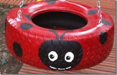 Exactly what the tree could use behind the swing set. Super cute lady bug tire swing DIY