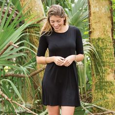Black Bailey Dress - This versatile, black shift dress features elbow-length sleeves and a hem that hits just above the knee. The Bailey Dress is super comfy and can easily be dressed up or down!