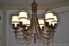 Creating your own custom Chandelier Shades. Such a simple way to spruce up a simple Chandelier.