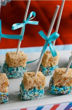Cute idea for Baby Showers, Kids Birthdays, Easter, or just a quick treat! Rice Krispy or LCM on lollypop sticks and dipped into white chocolate melts with sprinkes. Idea sourced from  www.Fondue-Treats.com