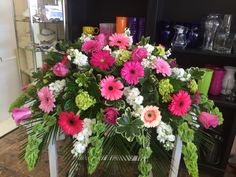 Shades of pink gerberra daisies casket spray by Donna Jeffries