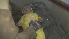 Rescue Worker Cries as He Pulls Baby Alive From Rubble in Syria - ABC News
