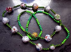 Items similar to Necklace from aluminum foil / candy wrapper balls globes spheres, wooden beads, recycled upcycled, OOAK on Etsy Ball Necklace, Candy Wrappers, Wooden Beads, Balls, Upcycle, Recycling, Beaded Bracelets, Globes, Handmade