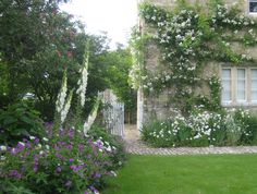Jinny Blom. Subtly augmented with simple stone walled gardens in the English vernacular, it is now brimming with cottage garden flowers such as Oxeye Daisy, Geraniums and Foxgloves amongst Lilacs and roses.