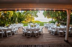 Location: Bayer Estate. Honolulu, Hawaii. www.bayerestate.com  Our dining terrace for your reception or dancing. This photo features our farm tables    Florals, linens, napkins & decor by :  www.designsbyhemingway.com Honolulu, Hawaii  Rentals : chairs , flatware, stemware  by www.accelrentals.com Honolulu, Hawaii  Photography by :  www.davemiyamoto.com Honolulu, Hawaii