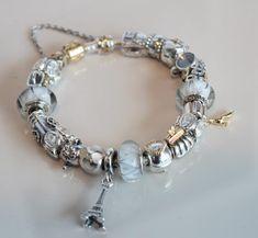 PANDORA two tone bracelet with white looking glass