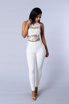- Available in Black and White - Sleeveless Jumpsuit - Mesh and Crotchet Lace Details - Zipper Back Closure - 100%Nylon