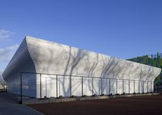 This gymnasium in Utrecht has no windows but features walls that swell outwards to let light in from above.
