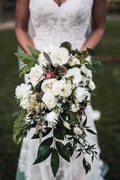 Gorgeous Cascading Wedding Bouquets ❤ See more: http://www.weddingforward.com/cascading-wedding-bouquets/ #weddings
