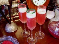 Christmas Eve Champagne Punch  1 container of Raspberry, Orange or Rainbow Sherbet (or whatever flavor you prefer)  1 two liter bottle of Ginger Ale  1 Magnum bottle of Asti Spumante Champagne (our favorite)  1 bag of frozen fruit (strawberries/peaches)  Freeze a pretty mold of ice    Empty one container of sherbet in a large punch bowl, add the fruit. Pour in the 2 liter bottle of Ginger Ale and one bottle of Champagne. Gently put in the ice mold.