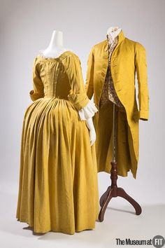 """Silk faille dress, and man's coat, ca. 1770. The yellow color of this dress on the left was particularly trendy during the 18th century. Prior to this period, Europeans negatively associated yellow with """"heretics,"""" but in China it was an auspicious color associated with the emperor. The transformation of yellow's cultural meaning was prompted by the growing popularity of chinoiserie that developed with the influx of goods imported to Europe from China."""