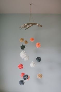 antler mobile with yarn poms - pearls on a string
