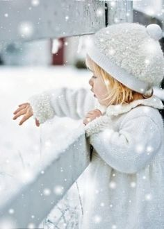 Child catching snowflakes