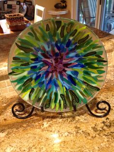 10 inch bowl utilizing opaque and translucent scrap on a clear circle. Slumped into a deep bowl. By Kim Natwig. Slumped Glass, Fused Glass Plates, Fused Glass Art, Stained Glass, Glass Bowls, Melting Glass, Glass Fusion Ideas, Glass Fusing Projects, Kiln Formed Glass