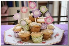 Use cupcakes as placeholders at a table: put them in cute cupcake holders and stick matching nametags with each child's name in them.