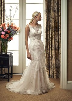 Beaded and embroidered tulle overlay with tank straps and scoop neckline and illusion back. Beaded lace overlay is finished with a scalloped hemline. Remove ...
