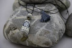 Création+de+Coline.+Pendentif+Matriochka Sautoir+composé+d'une+perle+Matriochka+en+verre+de+Murano...